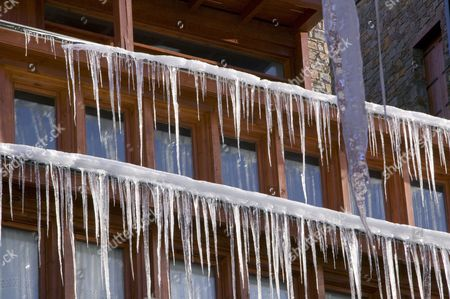 Icicles hanging from a chalet roof in the Andorran ski resort of Soldeu el Tarter
