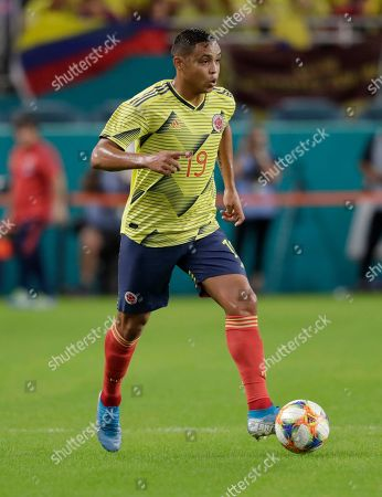 Colombia forward Luis Muriel (19) runs with the ball during the first half of an international friendly soccer match against Peru, in Miami Gardens, Fla
