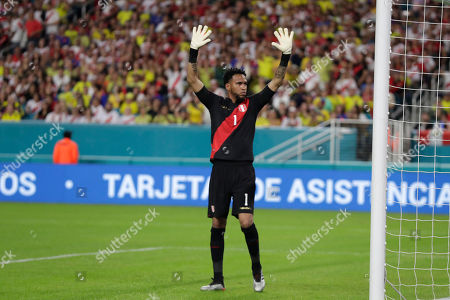Peru goalkeeper Pedro Gallese stands at the net during the first half of an international friendly soccer match against Colombia, in Miami Gardens, Fla
