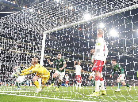 Denmark's Kasper Schmeichel fails to stop a goal scored by Matt Doherty of Ireland