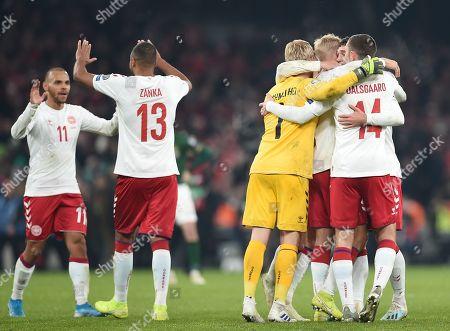 Denmark's Mathias Jorgensen, Martin Braithwaite, Kasper Schmeichel, Henrik Dalsgaard and Andreas Christensen celebrate at full time.