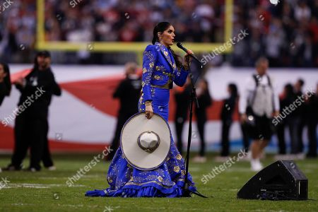 Ana Barbara sings the national anthem of Mexico before an NFL football game between the Los Angeles Chargers and the Kansas City Chiefs, in Mexico City