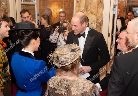 Prince William attends the Royal Variety Performance meeting the cast of Mary Poppins including Petula Clark in the beige hat