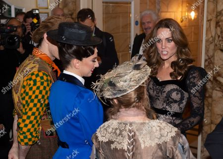 Catherine Duchess of Cambridge attends the Royal Variety Performance meeting the cast of Mary Poppins including Petula Clark in the beige hat