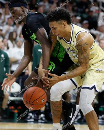 Gabe Brown, Sean Price. Michigan State forward Gabe Brown (44) and Charleston Southern guard Sean Price (23) reach for the rebound during the second half of an NCAA college basketball game, in East Lansing, Mich