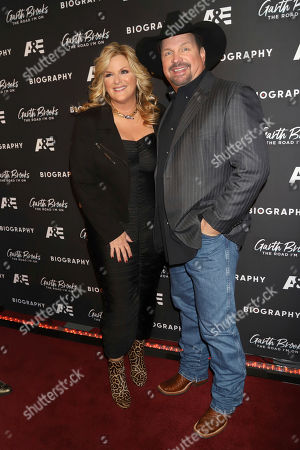 """Trisha Yearwood, Garth Brooks. Trisha Yearwood, left, and Garth Brooks attend cocktails and conversation in celebration of A&E Biography's """"Garth Brooks: The Road I'm On"""" television special at The Bowery Hotel, in New York"""