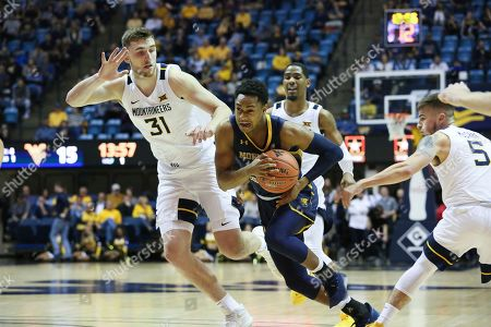 North Colorado's Matt Johnson(2) drives it up the court against West Virginia's Logan Routt (31), Taz Sherman (behind) and Jordan McCabe (5) during the first half of an NCAA college basketball game, Morgantown, W.Va