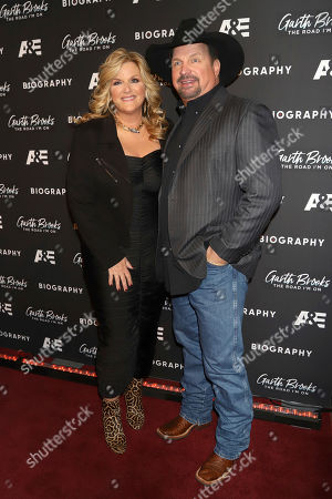 """Trisha Yearwood, Garth Brooks. Trisha Yearwood and Garth Brooks attend cocktails and conversation in celebration of A&E Biography's """"Garth Brooks: The Road I'm On"""" television special at The Bowery Hotel, in New York"""