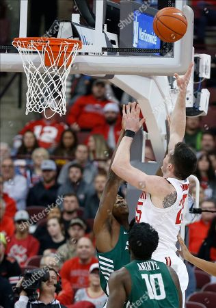 Ohio State's Kyle Young, right, shoots over Stetson's Rob Perry during the first half of an NCAA college basketball game, in Columbus, Ohio