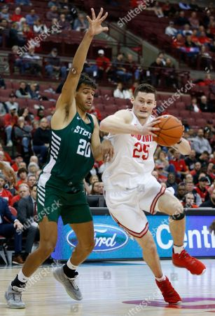 Ohio State's Kyle Young, right, drives to the basket against Stetson's Cyriaque Foucart during the second half of an NCAA college basketball game, in Columbus, Ohio
