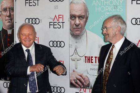 Anthony Hopkins (L) and Jonathan Pryce (R) react as they pose on the AFI Fest 2019 red carpet during the premiere of 'The Two Popes' at TCL Chinese Theatre in Hollywood, USA, 18 November 2019. â??The Two Popesâ?? will be released on Netflix on 20 December 2019.
