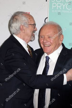 Anthony Hopkins (R) and Jonathan Pryce (L) react as they pose on the AFI Fest 2019 red carpet during the premiere of 'The Two Popes' at TCL Chinese Theatre in Hollywood, USA, 18 November 2019. â??The Two Popesâ?? will be released on Netflix on 20 December 2019.