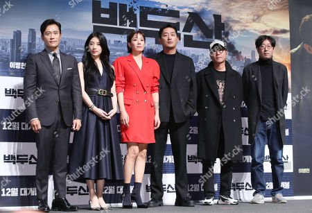 The cast of the new movie 'Ashfall', Lee Byung-hun, Bae Suzy, Jeon Hye-jin and Ha Jung-woo pose with co-directors Lee Hae-jun (2-R) and Kim Byung-seo (R) during a showcase at a theater in Seoul, South Korea, 19 November 2019. The movie tells the story of a massive eruption of a volcano on Mount Paekdu in North Korea and ensuing disasters across the Korean Peninsula. It will be in local theaters in December.