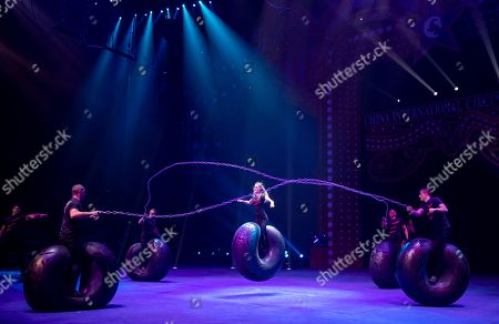 """Group """"Bikers"""" from Ukraine perform on the 6th China International Circus Festival in Zhuhai, Guangdong Province, China, 17 November 2019 (issued 19 November 2019). Zhuhai is a coastal city in Guangdong, Province, China. Also known as a Chinese Riviera just opposite to Macau. Borders Hong Kong to the east and Macau to the west. It is one of China's first Special Economic Zones. The world?s longest sea-crossing bridge, Hong Kong-Zhuhai-Macau bridge has become essential for coordinating innovative developments in cities of the Greater Bay Area. In one year nearly 500 new Macao enterprises were registered in Zhuhai's Hengqin Free Trade Zone. Zhuhai due location and neighboring cities start to attract more visitors with its entertainment business such as China International Circus Festival. China International Circus Festival is considered one of the top venues and the best-paid circus festivals in the world. First time held in 2013 and completed five successful seasons, attracted 45 countries circus playing teams, 134 boutique?s spectacular shows. The Monte-Carlo International Festival, also considered as a world-class festival will present shows in Zhuhai this year.  A total of 24 circus troupes and 200 performers from 22 countries will participate in the 6th China International Festival. Visitors can enjoy watching aerial acrobatics, extreme sports, magic shows and clowns in the Chimelong International Circus City.The design of the Chimelong International Circus City has been inspired by the story of The Lord of The Rings. A large circular LED screen has been embedded in the silver façade of the theater which looks like a diamond ring, adding a variety of modern effects offers a new visual experience."""