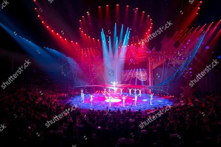 Artists perform on the 6th China International Circus Festival in Zhuhai, Guangdong Province, China, 17 November 2019 (issued 19 November 2019). Zhuhai is a coastal city in Guangdong, Province, China. Also known as a Chinese Riviera just opposite to Macau. Borders Hong Kong to the east and Macau to the west. It is one of China's first Special Economic Zones. The world?s longest sea-crossing bridge, Hong Kong-Zhuhai-Macau bridge has become essential for coordinating innovative developments in cities of the Greater Bay Area. In one year nearly 500 new Macao enterprises were registered in Zhuhai's Hengqin Free Trade Zone. Zhuhai due location and neighboring cities start to attract more visitors with its entertainment business such as China International Circus Festival. China International Circus Festival is considered one of the top venues and the best-paid circus festivals in the world. First time held in 2013 and completed five successful seasons, attracted 45 countries circus playing teams, 134 boutique?s spectacular shows. The Monte-Carlo International Festival, also considered as a world-class festival will present shows in Zhuhai this year.  A total of 24 circus troupes and 200 performers from 22 countries will participate in the 6th China International Festival. Visitors can enjoy watching aerial acrobatics, extreme sports, magic shows and clowns in the Chimelong International Circus City.The design of the Chimelong International Circus City has been inspired by the story of The Lord of The Rings. A large circular LED screen has been embedded in the silver façade of the theater which looks like a diamond ring, adding a variety of modern effects offers a new visual experience.