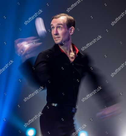 """Artists from France and Netherlands perform """"Tango Juggling"""" in Zhuhai, Guangdong Province, China, 17 November 2019 (issued 19 November 2019). Zhuhai is a coastal city in Guangdong, Province, China. Also known as a Chinese Riviera just opposite to Macau. Borders Hong Kong to the east and Macau to the west. It is one of China's first Special Economic Zones. The world?s longest sea-crossing bridge, Hong Kong-Zhuhai-Macau bridge has become essential for coordinating innovative developments in cities of the Greater Bay Area. In one year nearly 500 new Macao enterprises were registered in Zhuhai's Hengqin Free Trade Zone. Zhuhai due location and neighboring cities start to attract more visitors with its entertainment business such as China International Circus Festival. China International Circus Festival is considered one of the top venues and the best-paid circus festivals in the world. First time held in 2013 and completed five successful seasons, attracted 45 countries circus playing teams, 134 boutique?s spectacular shows. The Monte-Carlo International Festival, also considered as a world-class festival will present shows in Zhuhai this year.  A total of 24 circus troupes and 200 performers from 22 countries will participate in the 6th China International Festival. Visitors can enjoy watching aerial acrobatics, extreme sports, magic shows and clowns in the Chimelong International Circus City.The design of the Chimelong International Circus City has been inspired by the story of The Lord of The Rings. A large circular LED screen has been embedded in the silver façade of the theater which looks like a diamond ring, adding a variety of modern effects offers a new visual experience."""