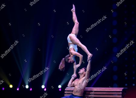"""Duo """"Destiny"""" from Poland and Portugal performs in Zhuhai, Guangdong Province, China, 17 November 2019 (issued 19 November 2019). Zhuhai is a coastal city in Guangdong, Province, China. Also known as a Chinese Riviera just opposite to Macau. Borders Hong Kong to the east and Macau to the west. It is one of China's first Special Economic Zones. The world?s longest sea-crossing bridge, Hong Kong-Zhuhai-Macau bridge has become essential for coordinating innovative developments in cities of the Greater Bay Area. In one year nearly 500 new Macao enterprises were registered in Zhuhai's Hengqin Free Trade Zone. Zhuhai due location and neighboring cities start to attract more visitors with its entertainment business such as China International Circus Festival. China International Circus Festival is considered one of the top venues and the best-paid circus festivals in the world. First time held in 2013 and completed five successful seasons, attracted 45 countries circus playing teams, 134 boutique?s spectacular shows. The Monte-Carlo International Festival, also considered as a world-class festival will present shows in Zhuhai this year.  A total of 24 circus troupes and 200 performers from 22 countries will participate in the 6th China International Festival. Visitors can enjoy watching aerial acrobatics, extreme sports, magic shows and clowns in the Chimelong International Circus City.The design of the Chimelong International Circus City has been inspired by the story of The Lord of The Rings. A large circular LED screen has been embedded in the silver façade of the theater which looks like a diamond ring, adding a variety of modern effects offers a new visual experience."""