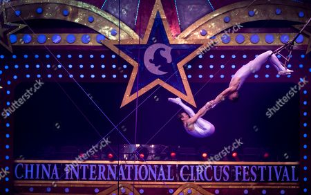 Artists from Russia perform on the 6th China International Circus Festival in Zhuhai, Guangdong Province, China, 17 November 2019 (issued 19 November 2019). Zhuhai is a coastal city in Guangdong, Province, China. Also known as a Chinese Riviera just opposite to Macau. Borders Hong Kong to the east and Macau to the west. It is one of China's first Special Economic Zones. The world?s longest sea-crossing bridge, Hong Kong-Zhuhai-Macau bridge has become essential for coordinating innovative developments in cities of the Greater Bay Area. In one year nearly 500 new Macao enterprises were registered in Zhuhai's Hengqin Free Trade Zone. Zhuhai due location and neighboring cities start to attract more visitors with its entertainment business such as China International Circus Festival. China International Circus Festival is considered one of the top venues and the best-paid circus festivals in the world. First time held in 2013 and completed five successful seasons, attracted 45 countries circus playing teams, 134 boutique?s spectacular shows. The Monte-Carlo International Festival, also considered as a world-class festival will present shows in Zhuhai this year.  A total of 24 circus troupes and 200 performers from 22 countries will participate in the 6th China International Festival. Visitors can enjoy watching aerial acrobatics, extreme sports, magic shows and clowns in the Chimelong International Circus City.The design of the Chimelong International Circus City has been inspired by the story of The Lord of The Rings. A large circular LED screen has been embedded in the silver façade of the theater which looks like a diamond ring, adding a variety of modern effects offers a new visual experience.
