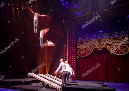 Stock Photo of Artists perform on the 6th China International Circus Festival in Zhuhai, Guangdong Province, China, 17 August 2019 (issued 19 August 2019). Zhuhai is a coastal city in Guangdong, Province, China. Also known as a Chinese Riviera just opposite to Macau. Borders Hong Kong to the east and Macau to the west. It is one of China's first Special Economic Zones. The world?s longest sea-crossing bridge, Hong Kong-Zhuhai-Macau bridge has become essential for coordinating innovative developments in cities of the Greater Bay Area. In one year nearly 500 new Macao enterprises were registered in Zhuhai's Hengqin Free Trade Zone. Zhuhai due location and neighboring cities start to attract more visitors with its entertainment business such as China International Circus Festival. China International Circus Festival is considered one of the top venues and the best-paid circus festivals in the world. First time held in 2013 and completed five successful seasons, attracted 45 countries circus playing teams, 134 boutique?s spectacular shows. The Monte-Carlo International Festival, also considered as a world-class festival will present shows in Zhuhai this year.  A total of 24 circus troupes and 200 performers from 22 countries will participate in the 6th China International Festival. Visitors can enjoy watching aerial acrobatics, extreme sports, magic shows and clowns in the Chimelong International Circus City.The design of the Chimelong International Circus City has been inspired by the story of The Lord of The Rings. A large circular LED screen has been embedded in the silver façade of the theater which looks like a diamond ring, adding a variety of modern effects offers a new visual experience.