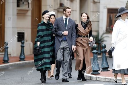 Pierre Casiraghi (C), his wife Beatrice (L) and Princess Charlotte of Hanover (R) attend the celebrations marking Monaco's National Day at the Monaco Palace in Monaco, 19 November 2019.