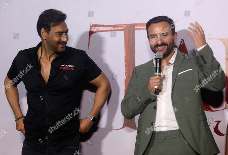 Ajay Devgn, Saif Ali Khan. Bollywood actor Ajay Devgn, left, looks at Saif Ali Khan speak during the trailer launch of their upcoming film Tanhaji in Mumbai, India, . The film is scheduled for release on Jan. 10
