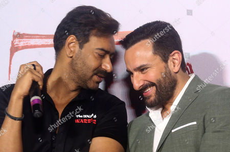 Ajay Devgn, Saif Ali Khan. Bollywood actors Ajay Devgn, left, speaks with Saif Ali Khan during the trailer launch of their upcoming film Tanhaji in Mumbai, India, . The film is scheduled for release on Jan. 10