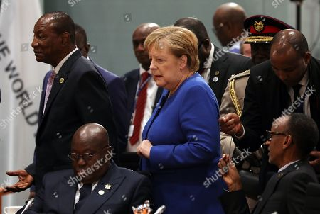 German Chancellor Angela Merkel (C), the President of Guinea Alpha Conde (L), the President of Ghana Nana Addo Dankwa Akufo-Addo (2-L) and the President of Rwanda Paul Kagame (R) take part in the G20 Compact with Africa conference in the Chancellery in Berlin, Germany, 19 November 2019. The G20 Compact with Africa summit takes place from 18 to 20 November 2019.