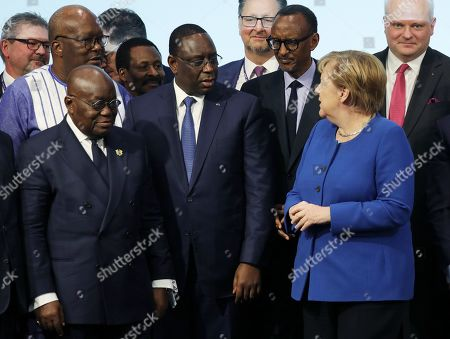German Chancellor Angela Merkel (R) speaks with the President of Ghana, Nana Ando Dankwa Akufo-Addo (L), the President of Senegal, Macky Sall (C) and the President of Rwanda, Paul Kagame (2-R), in the G20 conference Compact with Africa in Berlin, Germany, 19 November 2019. In the high-level conference investment summit the African Compact partner countries meet with high-ranking representatives of German companies to explore investments under the framework of the G20 partnership with Africa.