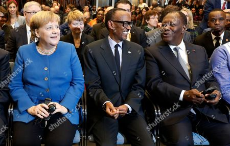 German Chancellor Angela Merkel (R) sits next to the President of Rwanda, Paul Kagame (C) and the President of Ivory Coast, Alassane Ouattara, as they attend the 'G20 Investment Summit - German Business and the CwA Countries the Compact with Africa (CwA)' in Berlin, Germany, 19 November 2019. In the high-level conference investment summit the African Compact partner countries meet with high-ranking representatives of German companies to explore investments under the framework of the G20 partnership with Africa.