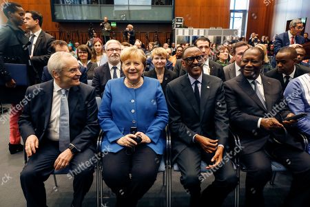 German Chancellor Angela Merkel (2-L) sits next to the Chairman for Subsahara Africa Initiative of German Business, Heinz Walter Grosse (L) and the Presidents of Rwanda, Paul Kagame (3-L), and of Ivory Coast, Alassane Ouattara (R), as they attend the 'G20 Investment Summit - German Business and the CwA Countries the Compact with Africa (CwA)' in Berlin, Germany, 19 November 2019. In the high-level conference investment summit the African Compact partner countries meet with high-ranking representatives of German companies to explore investments under the framework of the G20 partnership with Africa.