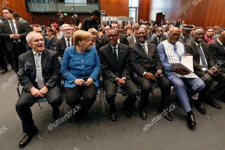 German Chancellor Angela Merkel (2-L) sits next to the Chairman for Subsahara Africa Initiative of German Business, Heinz Walter Grosse (L) and the Presidents of Rwanda, Paul Kagame (3-L), of Ivory Coast, Alassane Ouattara (4-L) and of Burkina Faso, Roch Marc Christian Kabore (2-R), as they attend the 'G20 Investment Summit - German Business and the CwA Countries the Compact with Africa (CwA)' in Berlin, Germany, 19 November 2019. In the high-level conference investment summit the African Compact partner countries meet with high-ranking representatives of German companies to explore investments under the framework of the G20 partnership with Africa.