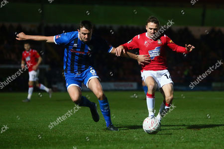 Rochdale's Eoghan O'Connell and Wrexham?s Paul Rutherford