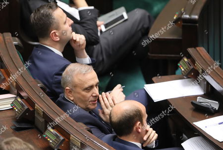Head of main opposition party Civic Platform (PO) Grzegorz Schetyna (C) and Leader of the Polish People's Party (PSL) Wladyslaw Kosiniak-Kamysz (top) react during a policy speech of the Polish Prime Minister Mateusz Morawiecki in Sejm (lower house) in Warsaw, Poland, 19 November 2019. The Sejm then takes a vote of confidence in the new cabinet.