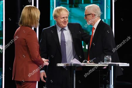 Julie Etchingham, Jeremy Corbyn and Boris Johnson during tonight's live debate (Picture available for editorial use only until December 19th 2019)
