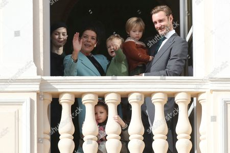 Beatrice Borromeo, Princess Caroline of Hanover, Francesco Casiraghi, Pierre Casiraghi, Stefano Casiraghi. Beatrice Borromeo, from left, Princess Caroline of Hanover holding Francesco Casiraghi, India Casiraghi, bottom, and Pierre Casiraghi holding his son Stefano Casiraghi look down from the balcony during the ceremonies marking the National Day in Monaco, Tuesday, Nov.19, 2018
