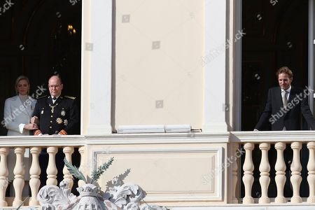 Stock Photo of Prince Albert II of Monaco, Princess Charlene, Andrea Casiraghi. Prince Albert II of Monaco, with his wife Princess Charlene, left, and Andrea Casiraghi, right, look down from the balcony during the ceremony marking the National Day in Monaco, Tuesday, Nov.19, 2018