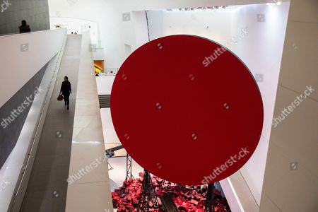 Visitors walk past 'Symphony for a Beloved Sun' artwork during an exhibition of British-Indian artist Anish Kapoor, at the CAFA Art Museum, in Beijing, China, 19 November 2019. The first solo museum show in China for Anish Kapoor presents his most significant works and runs until 01 January 2020.