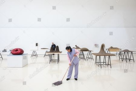 An employee cleans a floor during an exhibition of British-Indian artist Anish Kapoor, at the CAFA Art Museum in Beijing, China, 19 November 2019. The first solo museum show in China for Anish Kapoor presents his most significant works and runs until 01 January 2020.