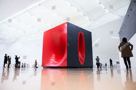 Visitors look at 'Sectional Body preparing for Monadic Singularity' artwork during an exhibition of British-Indian artist Anish Kapoor, at the CAFA Art Museum in Beijing, China, 19 November 2019. The first solo museum show in China for Anish Kapoor presents his most significant works and runs until 01 January 2020.