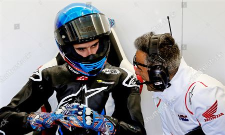 Spanish 2019 Moto2 world champion Alex Marquez (L) talks with a member of his new Repsol Honda Team before making his debut in the MotoGP category during the post-season official training session at Ricardo Tormo Circuit in Cheste, near Valencia, Spain, 19 November 2019. Alex Marquez joins his brother 2019 MotoGP world champion Marc Marquez in the 2020 season, replacing compatriot Jorge Lorenzo becoming the first pair of siblings in the same MotoGP team.