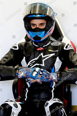 Spanish 2019 Moto2 world champion Alex Marquez prepares in the garage of his new Repsol Honda Team before making his debut in the MotoGP category during the post-season official training session at Ricardo Tormo Circuit in Cheste, near Valencia, Spain, 19 November 2019. Alex Marquez joins his brother 2019 MotoGP world champion Marc Marquez in the 2020 season, replacing compatriot Jorge Lorenzo becoming the first pair of siblings in the same MotoGP team.