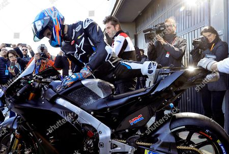 Spanish 2019 Moto2 world champion Alex Marquez gets on the bike of his new Repsol Honda Team before making his debut in the MotoGP category during the post-season official training session at Ricardo Tormo Circuit in Cheste, near Valencia, Spain, 19 November 2019. Alex Marquez joins his brother 2019 MotoGP world champion Marc Marquez in the 2020 season, replacing compatriot Jorge Lorenzo becoming the first pair of siblings in the same MotoGP team.
