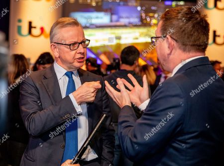 Stock Photo of Michael Gove and Andrew Gwynne during an interview at tonight's debate in the 'Spin Room' (Picture available for editorial use only until December 19th 2019)
