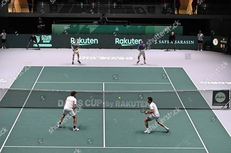 Kazakh tennis players Andrei Golubev (R-up) and Aleksandr Nedoviesov (L-up) in action against Dutch Jean-Julien Rojer (R-down) and Wesley Koolhof (L-down) in the group stage tie between Chile and Argentina at Caja Magica pavilion, in Madrid, Spain, 19 November 2019.
