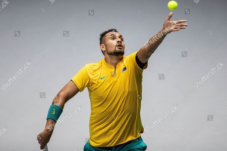 Australia's Nick Kyrgios serves to Colombia's Alejandro Gonzalez during their Davis Cup tennis match in Madrid, Spain