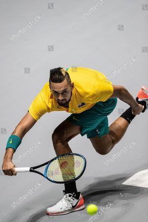 Australia's Nick Kyrgios returns the ball to Colombia's Alejandro Gonzalez during their Davis Cup tennis match in Madrid, Spain