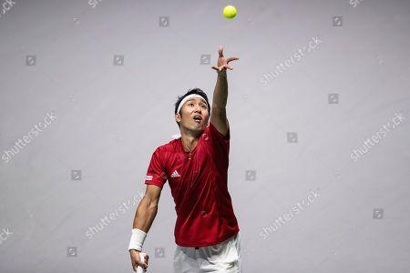 Japan's Yasutaka Uchiyama serves to France's Jo-Wilfried Tsonga during their Davis Cup tennis match in Madrid, Spain
