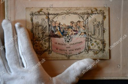 """The world's first printed Christmas card is displayed at the Dickens House Museum in Lon?don, Britain, 19 November 2019. The hand coloured lithograph card was produced in 1843 and sold for one shilling. The exhibition """"Dickens and the Business of Christmas"""" opens 20 November 2019 until 19 April 2020"""