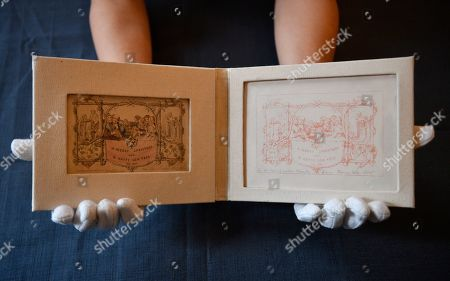 """Stock Picture of The world's first printed Christmas card is displayed at the Dickens House Museum in Lon?don, Britain, 19 November 2019. The hand coloured lithograph card was produced in 1843 and sold for one shilling. The exhibition """"Dickens and the Business of Christmas"""" opens 20 November 2019 until 19 April 2020"""