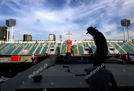 Workers prepare the stage at the National stadium from where Pope Francis is scheduled to conduct holy mass on Thursday, in Bangkok, Thailand, . Pope Francis arrives in Thailand on Wednesday for the first visit here by the head of the Roman Catholic Church since St. John Paul II in 1984